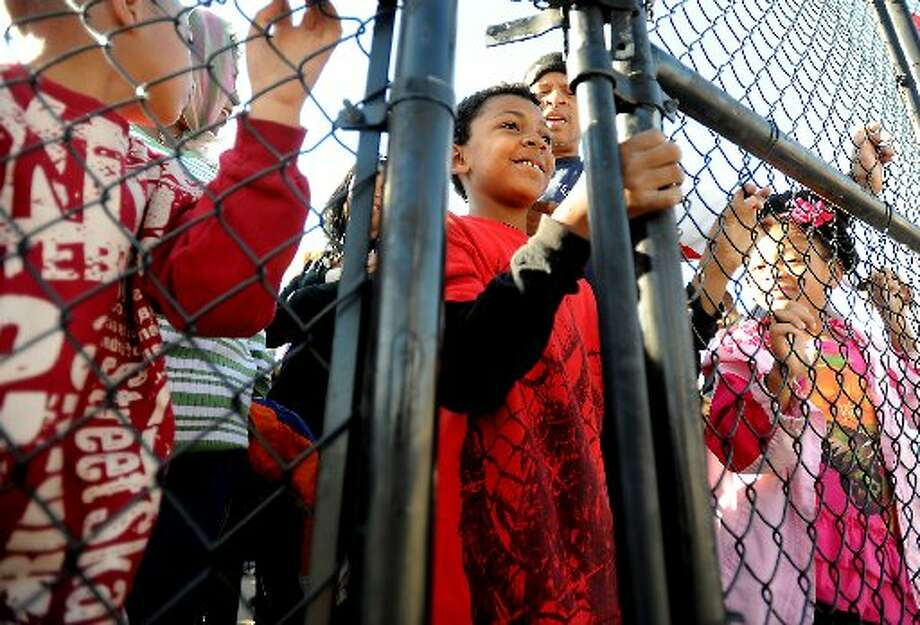 Trayvon Vallery waits with hundreds of others for the gates to open Thursday at the opening day of the South Texas State Fair in Beaumont. Tammy McKinley/The Enterprise