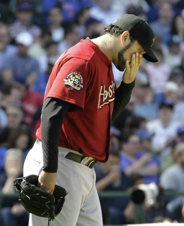 Houston Astros starting pitcher Felipe Paulino wipes his face after giving up a RBI double to Chicago Cubs' Alfonso Soriano that scored Marlon Byrd tying the game at 2-2 during the seventh inning of a baseball game Friday at Wrigley Field in Chicago. The Astros went on to lose 7-2. (Charles Rex Arbogast/The Associated Press) / AP2010