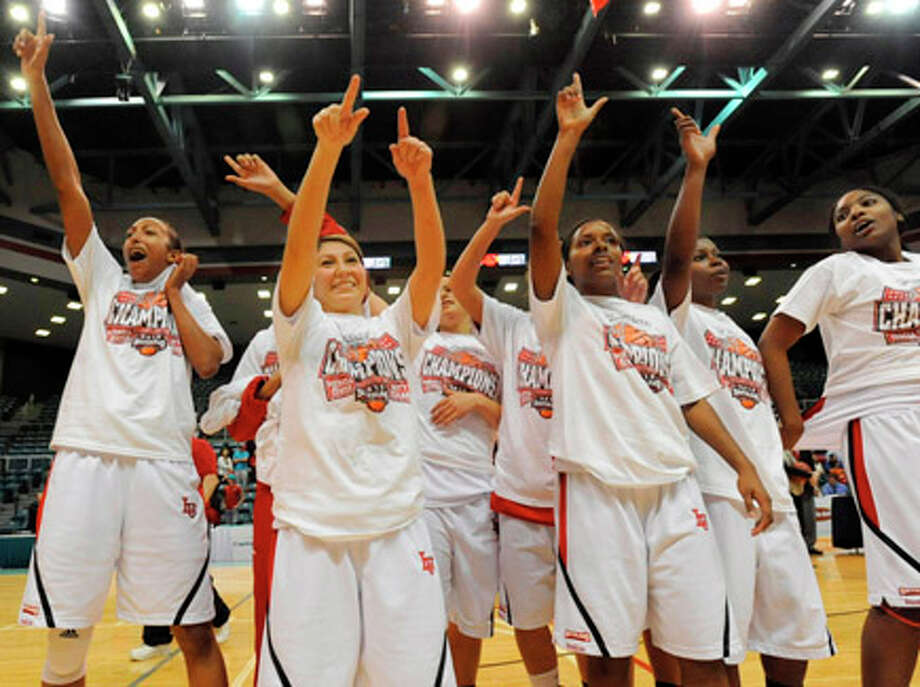 The Lamar Lady Cardinals celebrate their Southland Conference Tournament Championship after defeating Texas A&M Corpus Christi 86-59 at the Merrell Center in Katy in March. Valentino Mauricio/The Enterprise / Beaumont
