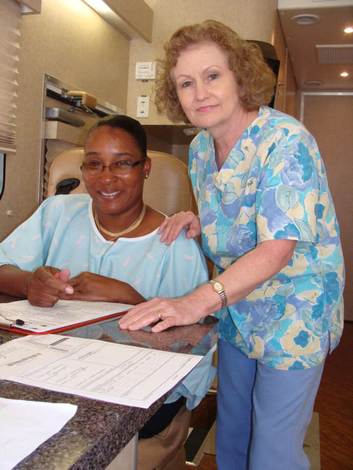 """Gift of Life"" mammography screening client, Glenda Green, and UTMB Mammography Technician, Theresa Quevedo."