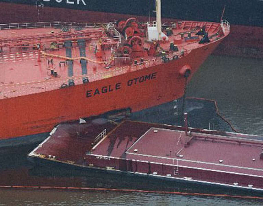 A barge pushed by the Dixie Vegence made a large impact gash in the side of the Eagle Otome after two vessels collided Jan. 23, 2010, near Port Arthur. Julio Cortez/Houston Chronicle