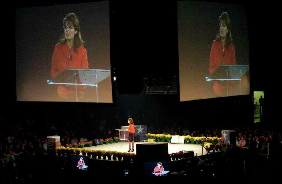 Sarah Palin, former Alaska governor and 2008 Republican vice presidential nominee, greets attendees at the Get Motivated seminar at the Beaumont Civic Center this morning. Dave Ryan/The Enterprise / Beaumont