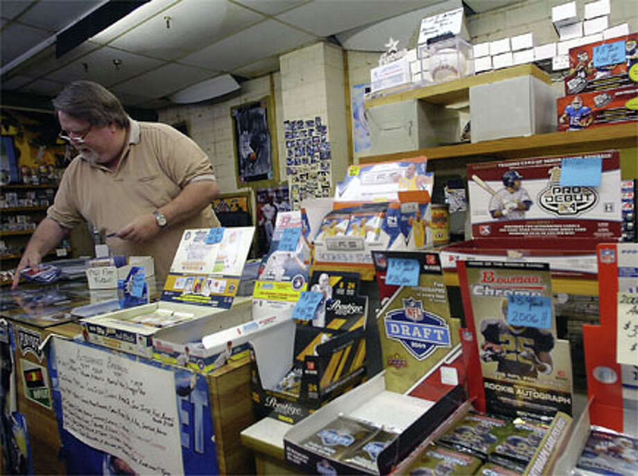 """Richard Tyner, better known as """"Coach,"""" has been collecting and trading sports collectibles for 30 years. In his shop, located on 11th Street at the old K-Mart Flea Market/Bingo Hall, Tyner has just about everything including boxes of old and new trading cards of all types. Dave Ryan/The Enterprise"""
