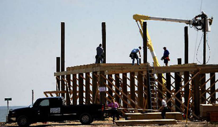 Construction on new homes continued Wednesday on the Bolivar Peninsula. Some scientists predict a possible twelve inch rise of sea levels in the next century which would result in a loss of a mile of land along the coast. Tammy McKinley/The Enterprise