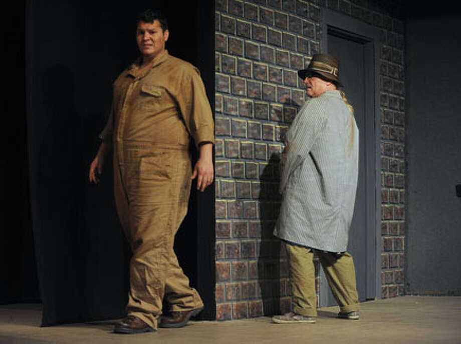 """Joseph Strong, played by Paul Birch, defies the laws by not paying for the 'privilege to pee' in the Orange Community Playhouse's version of """"Urinetown."""" Guiseppe Barranco/The Enterprise / Beaumont"""