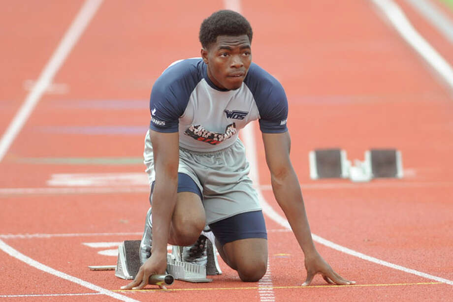 West Orange-Starks's Justin Thomas gets set in the blocks  before starting the first leg of the boys 3A 4x100 meter relay at the UIL State Track and Field Championships in Austin on Saturday.  Along with teammates Trey Franks, Phillip Jones, and James Haynes, the Mustangs took home the gold with a winning time of 41.49 . May 15, 2010. Valentino Mauricio/The Enterprise