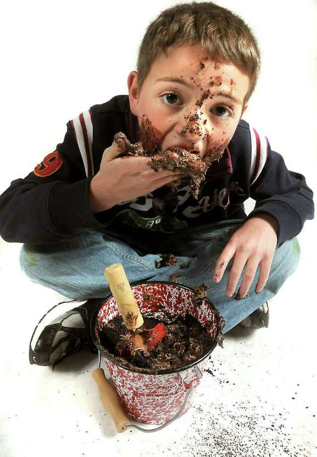 "Nolan Moore eats ""mud"". Some studies suggest that playing in and eating dirt can help boost immune systems for children and may have some heart benefits. Tammy McKinley/ The Enterprise / Beaumont"