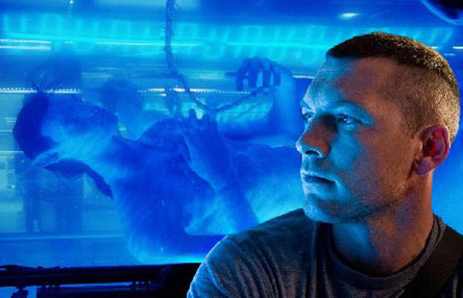 "Actor Sam Worthington is shown in a scene in James Cameron's 3D sci-fi adventure ""Avatar.""  Twentieth Century Fox Film Corp./The Associated Press"