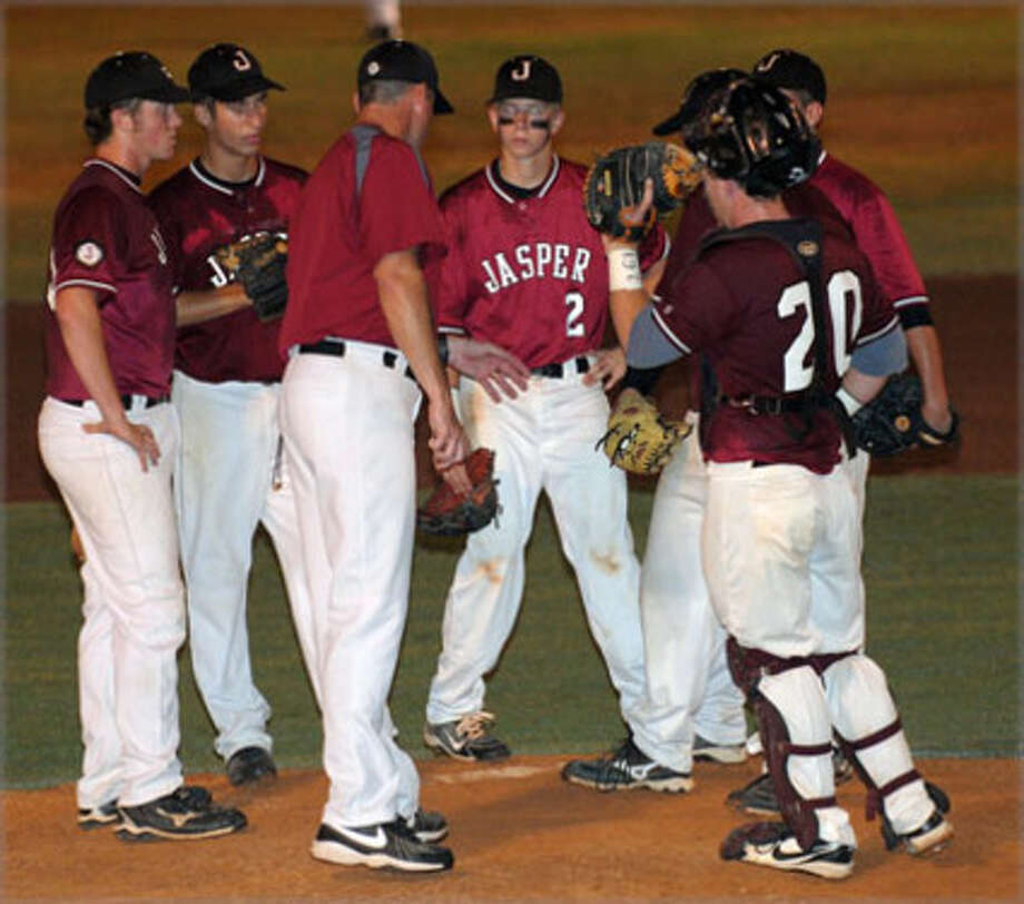 Jasper Head Baseball Coach Shawn Mixon holds a mound conference during Jasper's 10-5 loss to Bridge City Thursday, May 27 in Woodville.