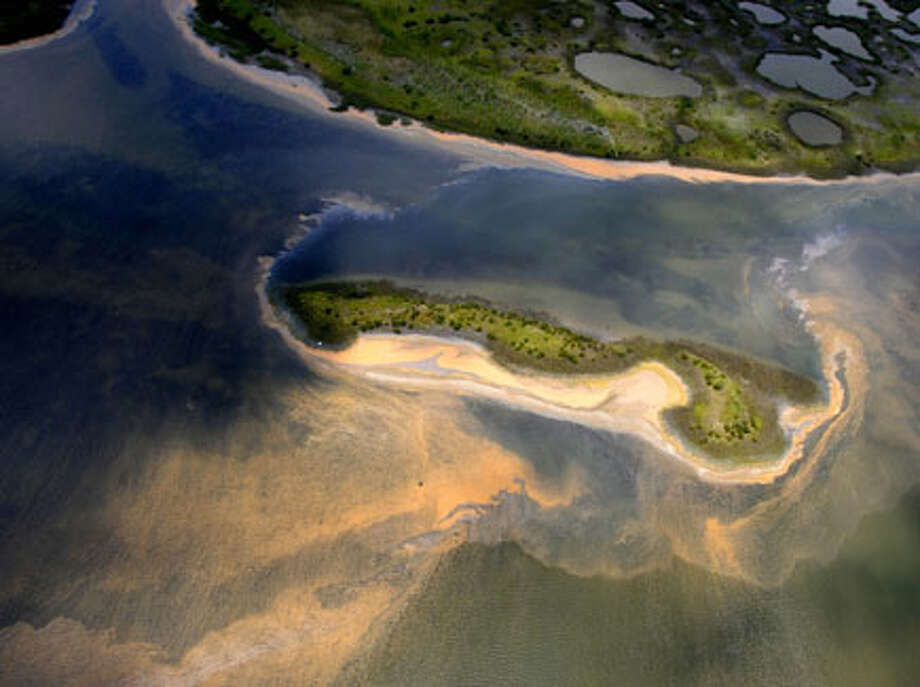 An aerial view of the northern Chandeleur barrier islands shows sheens of oil reaching land May 6 in the Gulf of Mexico. The islands rest 20 miles from the main Louisiana coastline. AP Photo/David Quinn