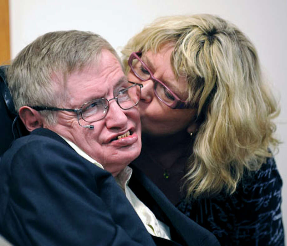Theoretical physicist Stephen Hawking gets a kiss from Beverly Guster before the dedication of an auditorium named after him at the George P. and Cynthia Woods Mitchell Institute for Fundamental Physics and Astronomy on the Texas A&M campus Monday in College Station. Guster is a staff member of the Institute. Dave Einsel/The Associated Press / FR43584 AP