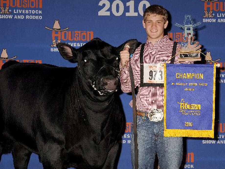 Johnny Ray Lively, a sophomore at Hardin Jefferson High School, won grand champion Angus at the 2010 Houston Livestock Show and Rodeo.  Photo provided by Johnny Ray Lively
