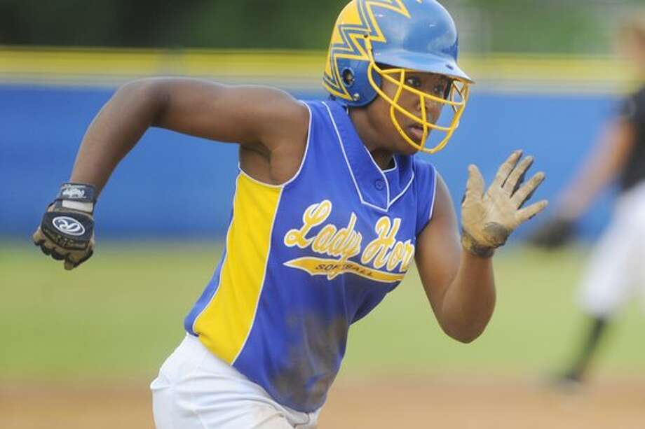 Hamshire-Fannett runner Lindsey Stephens rounds third base scoring against  Liberty in the first inning during district playoff action at Hamshire-Fannett High School on April 30th. Valentino Mauricio/The Enterprise / Beaumont