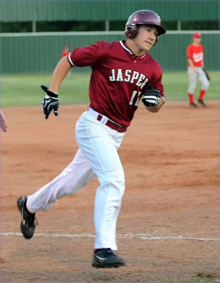 Sam Alvis trots around the bases after hitting a home run during a recent home game.