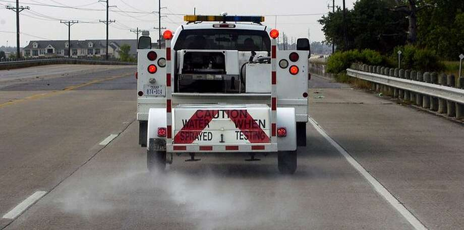 Approximately 6000 lane miles of road, inside eight counties, has to be routinely checked by the Texas Department of Transportation. Using a truck pulling a Skid Unit, Johnny Perez, District Pavement Engineer Specialist 2, and his driver Joe Sterling, are the ones to do it in a truck/trailer combination like this. The trailer carries skid resistance testing equipment and the truck carries the water which is sprayed onto the road.  Dave Ryan/The Enterprise / Beaumont