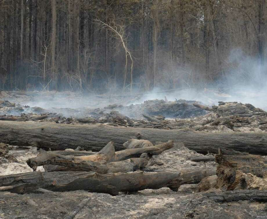 A patch of land on FM 1943 was still smoldering Friday afternoon. Beth Rankin/The Enterprise