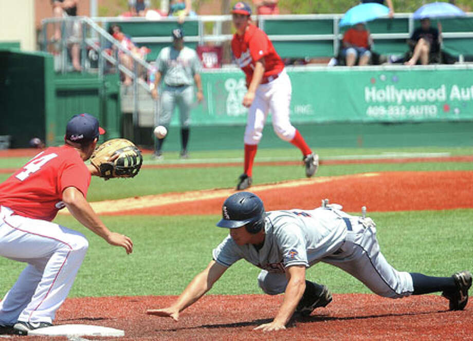 Lamar's Wade Mathis reaches out in vain efforts to tag out a UTSA runner during the Cardinal's matchup Sunday afternoon. Guiseppe Barranco/The Enterprise / Beaumont