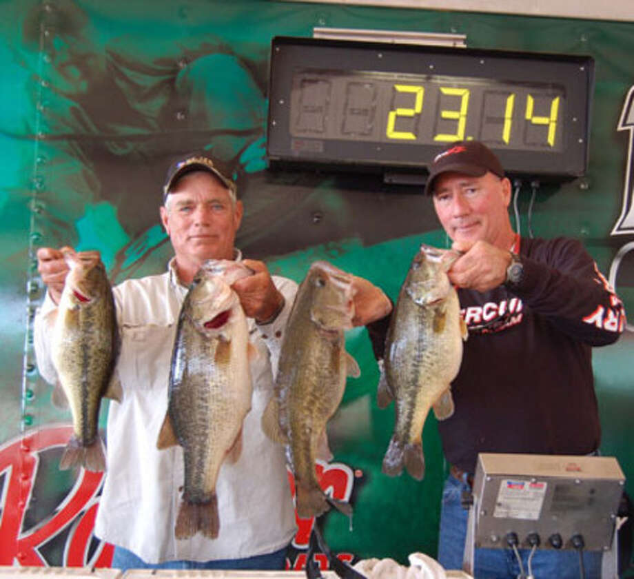 Jimmy Sorter shows off part of the winning catch for him and Gerald Granger with the help of Dave Concienne of Bass N Bucks.  Their 1st place win landed a check for $15,000