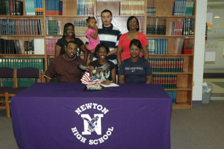 Ashlynn Stewart signs a college letter of intent to run track and field for Lon Morris Junior College. Pictured with Stewart are, front row, James Hanks, Ashlynn Stewart and Veronica Hanks. Back row, left to right, are Latisha Stewart, Journee Hanks, Johnny Brown, and Newton Track Coach Debra Alexander.