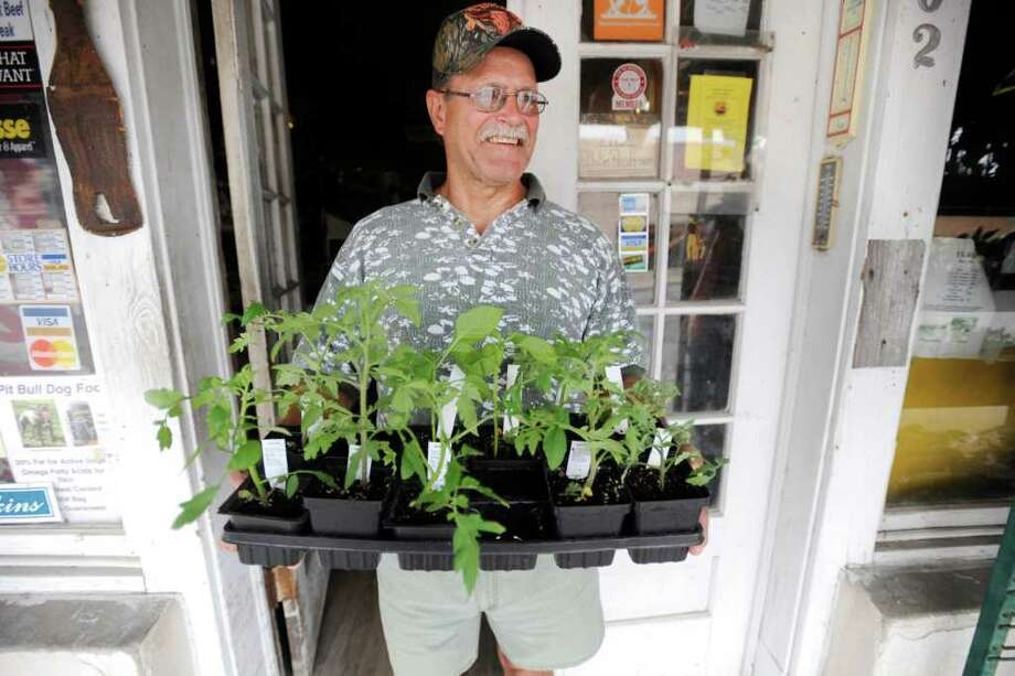 Bridge City resident Mickey David leaves the Farmers Mercantile in Orange with a flat of bell peppers and tomato plants ready for a weekend gardening project. Farmers Mercantile has been serving the agricultural community since 1928. The store is a throwback to an earlier time, but it's more than an archaic curiosity. It's still a vital business.  Valentino Mauricio/The Enterprise / Beaumont