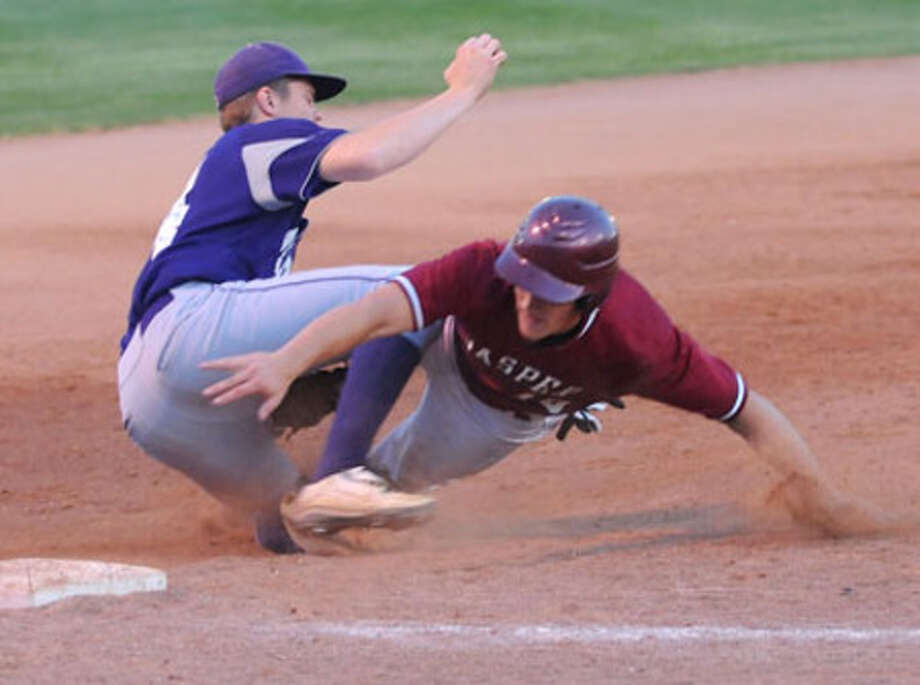 Jasper?s Sam Alvis is thrown out at third base on an attempted steal.