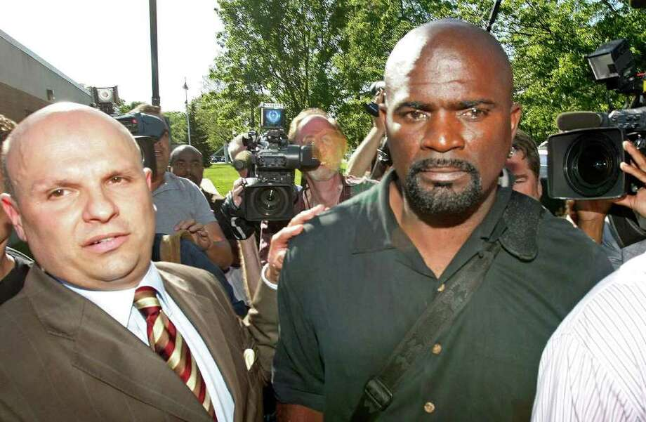 Pro Football  Hall of Famer Lawrence Taylor, right, and his attorney Arthur Idala, left, leave the Ramapo Police Department where he was arraigned on charges of third-degree rape and patronizing a prostitute at a nearby hotel in Suffern, N.Y. / AP