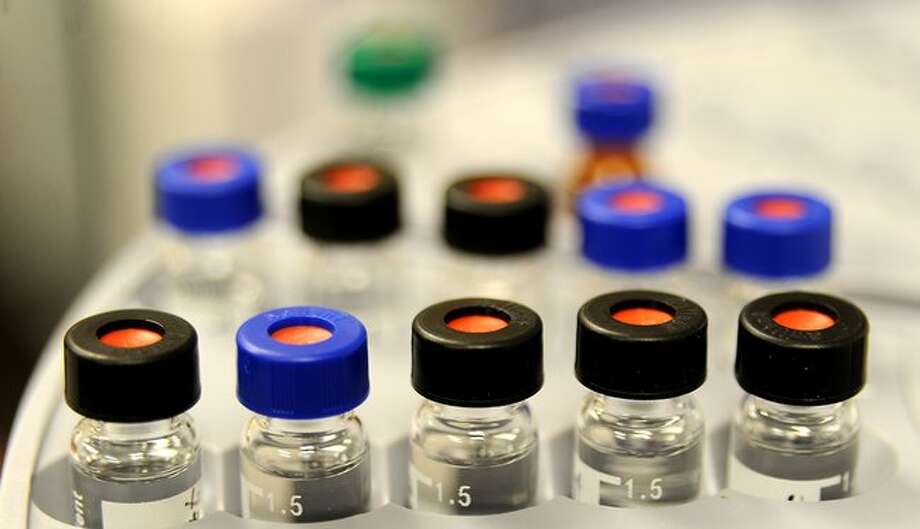 Vials of liquid wait to be tested to identify drugs at the Regional Crime Lab in Beaumont in February, 2009. Enterprise file photo / Beaumont