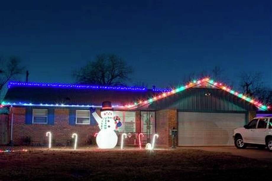 """In this photo taken on Dec. 19, 2009, Gary Barksdale's home in Norman, Okla. is decorated with a mix of vintage incandescent bulbs and LED lights for the holidays. """"It's part of the holiday tradition,"""" said Barksdale. (AP Photo/Alonzo Adams) / AP Photo/Alonzo Adams"""