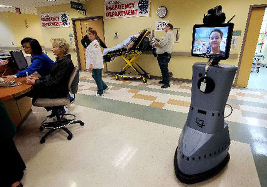 Keeping pace with high-tech medicne, Hermann Memorial Baptist Hospital boasts a robot capable of visually connecting stroke specialists in Houston with area victims. Guiseppe Barranco/The Enterprise