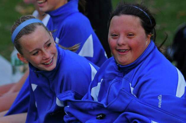 Shaker High School freshman Gianna MacPhee, right, and  teammate Meghan Kelly, try to stay warm Thursday during  their 1-0 loss to Shenendehowa in Latham. ( Philip Kamrass / Times Union ) Photo: Philip Kamrass