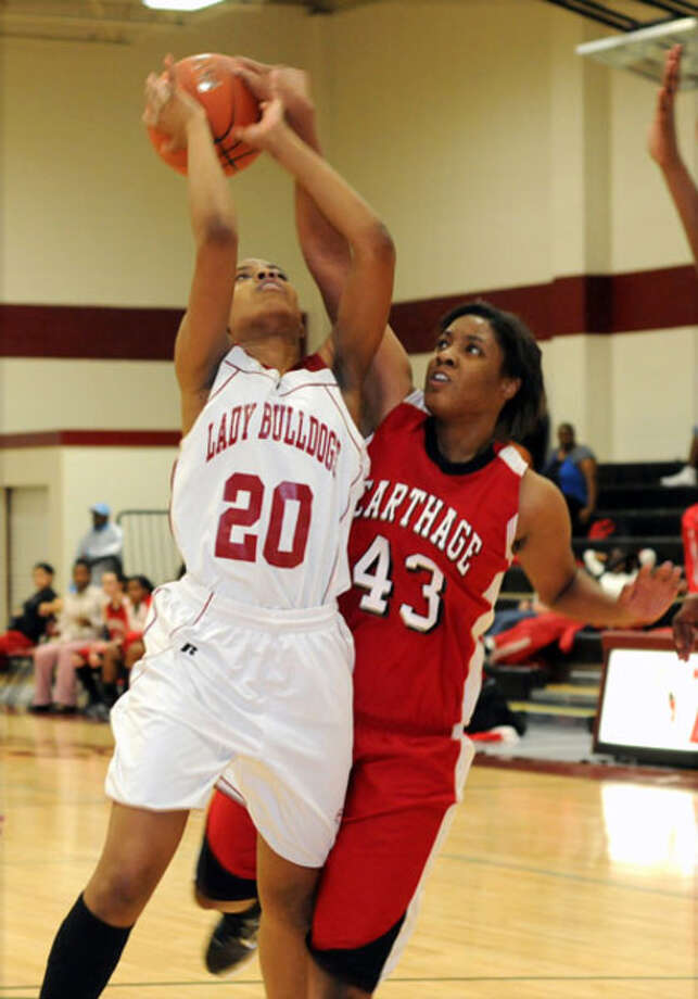 Breeunna Hafford finds her path to the bucket blocked by a Carthage defender during last week?s contest.