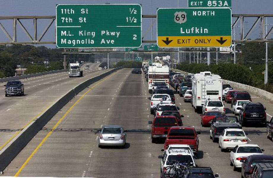 As traffic moves smoothly along Interstate 10 southbound, cars, trucks, RVs, etc., wait in a long line for U.S. 69 northbound with some movement coming every few minutes on Sept. 22, 2005, as Hurricane Rita approached Southeast Texas. Enterprise file photo