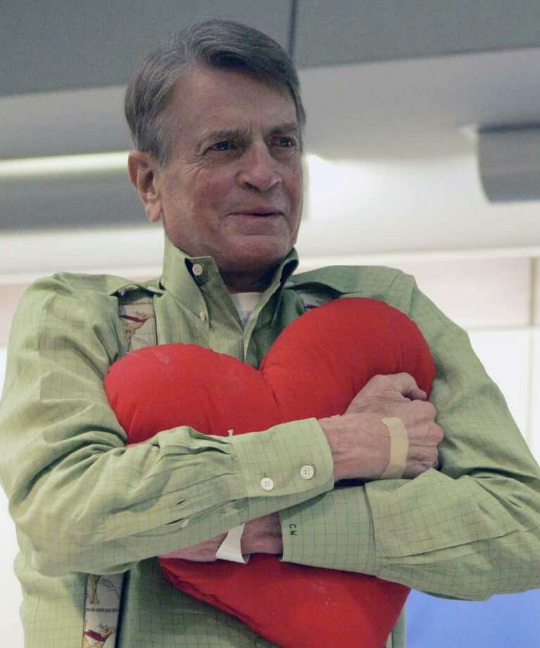 Former U.S. Rep. Charlie Wilson of East Texas hugs his heart-shaped pillow at a Houston hospital, Thursday, Oct. 4, 2007 just before his releas 10 days after receiving a heart transplant . (AP Photo/Pat Sullivan) / Beaumont