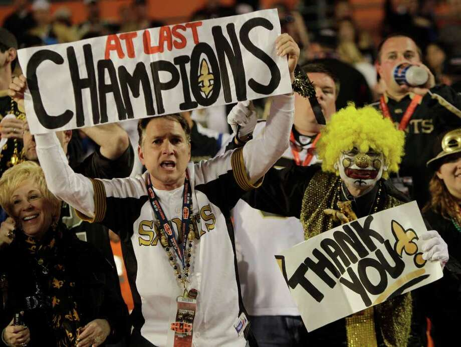 New Orleans Saints fans celebrate their team's victory after the NFL Super Bowl XLIV football game against the Indianapolis Colts. The Saints won 31-17. (AP Photo/Eric Gay) / AP