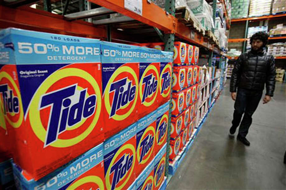 Tide Detergent, a Procter & Gamble product, is seen on display at Costco in Mountain View, Calif. Using too much detergent can harm your washer and not make your clothes any cleaner. Paul Sakuma/The Associated Press / AP