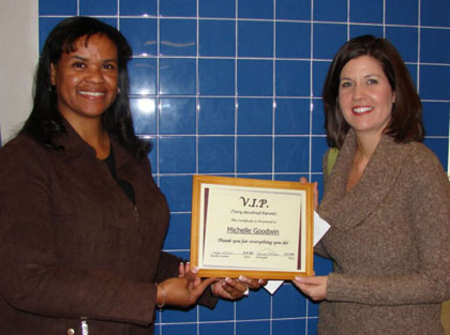 Michelle Goodwin being presented with the V.I.P award.