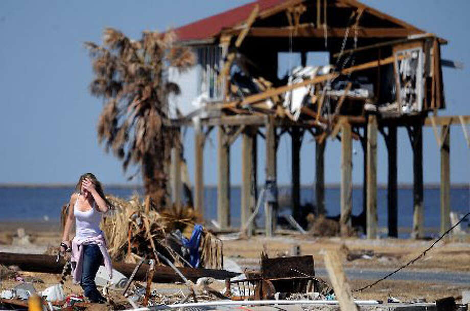 Rachel Segura surveys debris and searches for personal items swept from her Bolivar Peninsula home during Hurricane Ike. Enterprise file photo
