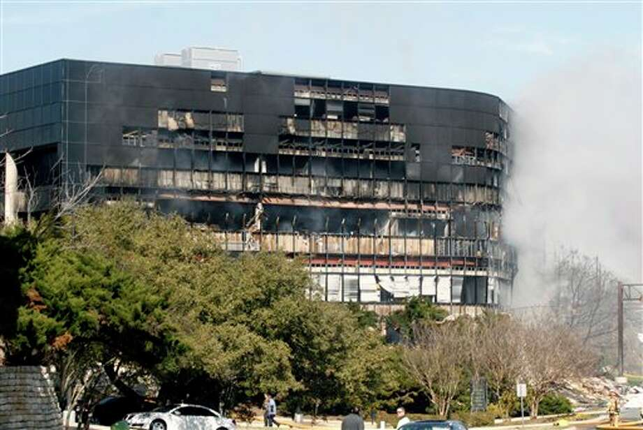 Smoke billows from a seven-story building after a small private plane crashed into the building  in Austin, Texas on Thursday Feb. 18, 2010.  (AP Photo/Jack Plunkett)