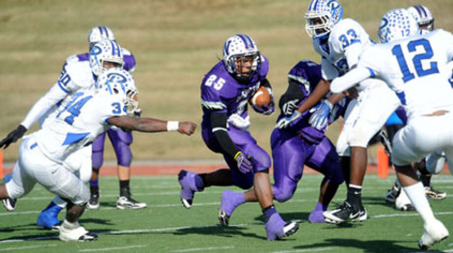 Newton's Jeremy Jackson runs the ball as a host of Daingerfield defenders look to tackle at the Homer Bryce Stadium at Stephen F. Austin University in Nacogdoches, Saturday. Tammy McKinley/ The Enterprise