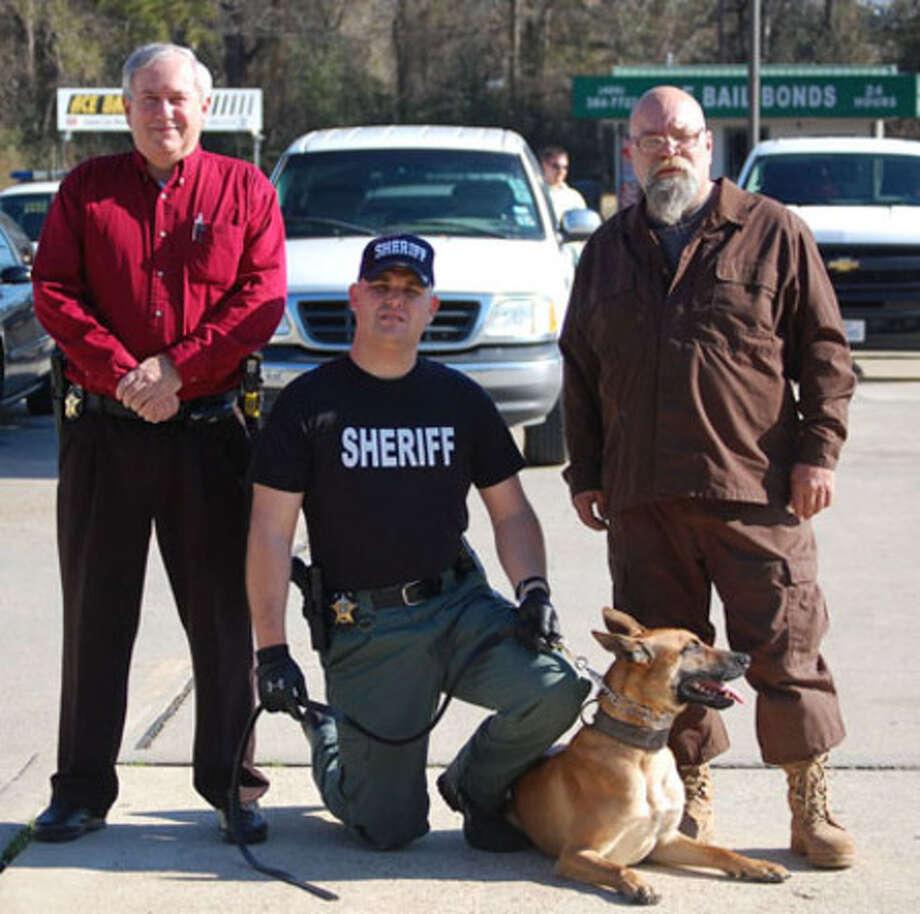Left to right: Jasper County Chief Deputy Ralph Nichols, Deputy Scott Jacks, K-9 Deputy Drake, and Norman Garner.