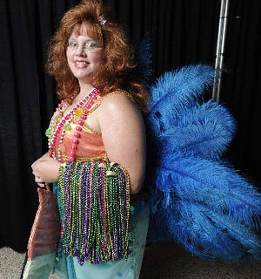Keri Norris of Port Arthur models her mermaid style Mardi Gras gown she made. Valentino Mauricio/The Enterprise