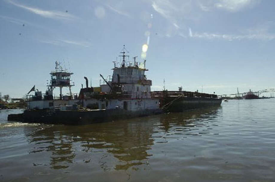 A tug and barge wait in the Sabine Neches Waterway to pass the Eagle Otome. Dave Ryan/The Enterprise