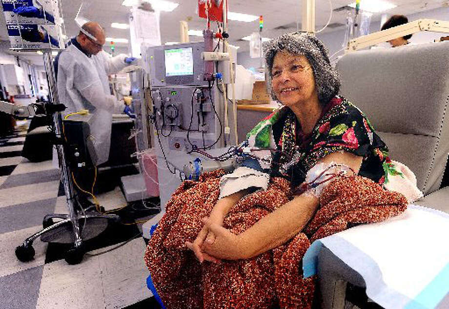 A dialysis patient for more than a year, Margarette Burdette sits in a chair for more than ten hours a week while her blood is filtered through a machine. Guiseppe Barranco/The Enterprise