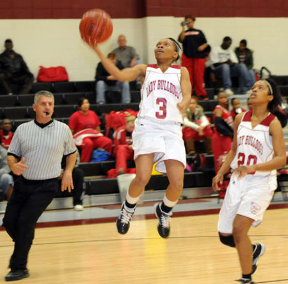 Jasper?s Michelle Wallace led Jasper' s scoring with  10 points in the district opening loss to Diboll.