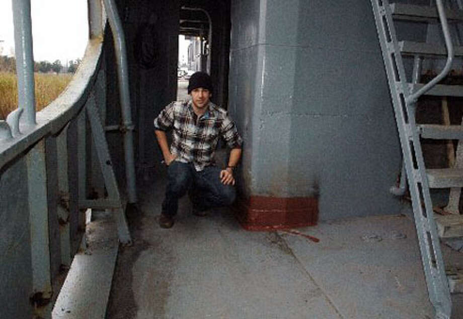 James Allison III, 22, came from the University of Texas at Austin to volunteer on the U.S.S. Orleck. Volunteers sealed parts of the ship and did some welding to get the ship ready to be towed to Lake Charles, La. The ship, which was built in 1944 in Orange, has been in Orange since 2000 after a local group acquired it from the Turkish Navy.  Margaret Toal/The Enterprise