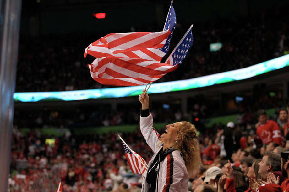 A USA fan waves Old Glory before the start of the USA-Canada men's hockey preliminary round match at Canada Hockey Place in Vancouver, British Columbia, Sunday, February 21, 2010. The Americans won 5-3. (John Lok/Seattle Times/MCT) / Seattle Times