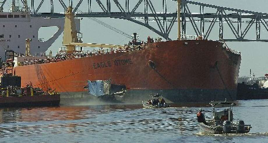 The Eagle Otome, holed just behind the bow from a collision with a barge, sits anchored in the middle of the Sabine Neches Waterway with emergency responders, oil spill specialists, and Coast Guard boats constantly patrolling. Dave Ryan/The Enterprise