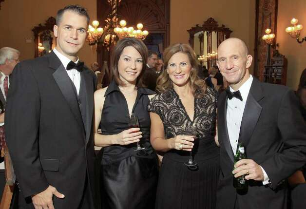 At the 2010 Down Syndrome Aim High Resource Center gala, from left: Fred Hinrichsen; Ann Hughes, the benefit's mistress of ceremonies and anchorwoman at Fox 23 News; Julie Koenig, the resource center's events coordinator; and Mike Koenig. (Joe Putrock / Special to the Times Union) Photo: Joe Putrock / Joe Putrock