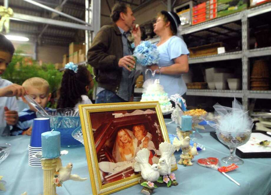 Just after exchanging vows in the lawn and garden department at the Silsbee WalMart, Connie and David Day share a bit of wedding cake. Beth Rankin/The Enterprise