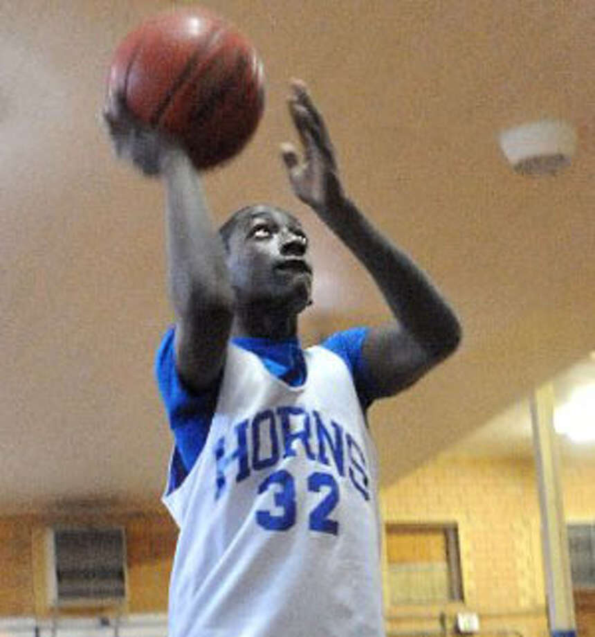 Jordan Hunter practices Wednesday at Hamshire-Fannett Middle School. He will participate in the Fit Dribble and Swish competition at the NBA All-Star game in Dallas on Feb. 12. Tammy McKinley/ The Enterprise